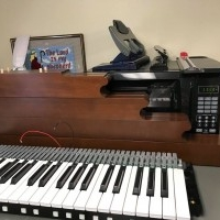 Four keyboards, pedalboard, key cheeks and music desk